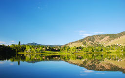 Lake Reflection with Homes Nearby stock photography