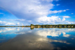 Lake reflection with rainbow Royalty Free Stock Photo