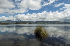 Lake. The reflection of sky and mountains in the kembar lake in the Padang Sumatra Indonesia Stock Photo