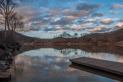 Lake Reflection at Sunset with Pier. Cloud Reflection on Lake at Sunset with Pier Stock Photography