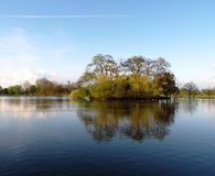 Lake Reflections. The reflections of an island in a lake during the evening light. Clapham Common, London stock photo