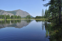 Lake and reflections of the mountains Stock Photography