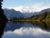 Lake reflections in New Zealand. Reflection of Mount Cook and Mount Tasmin  in Lake Mattheson South Island. Copy space Stock Photography