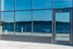 Lake Reflecton 3. Lake Washington is reflected in building windows in Renton, Washington stock photography