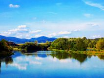 Lake with reflexion. Forest and sky Stock Photography