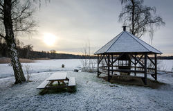 Lake rest place in winter. Idyllic December sunrise over Swedish lake Stock Photos