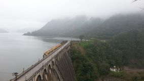 Great dam in the middle of mountains. stock photos