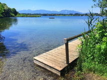 Lake Riegsee with wooden boardwalk Royalty Free Stock Images