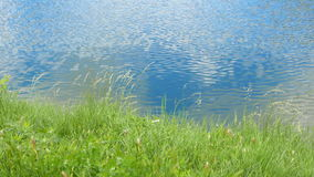 Lake, ripple on the water with the reflection of clouds stock footage