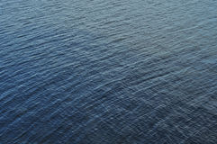 Lake, river, close-up. Textured, Small waves, blue, photography course for diagonalt Stock Images