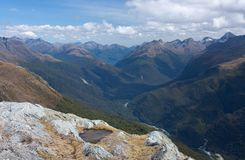 A lake, a river and mountains as seen from the top of the Conical Hill at the Harris Saddle at the Routeburn Great Walk, New stock images