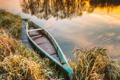 Lake, River and old wooden rowing fishing boat at beautiful sunr Royalty Free Stock Photography