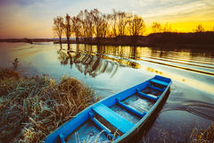Lake, River and old wooden rowing fishing boat at Royalty Free Stock Image