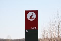 Lake and Riverfront Sign. A sign points guest to an area where boats, kayakers and swimmers can enter the lake Stock Photo
