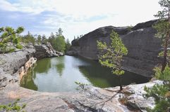 Lake on the rock. central kazakhstan. The karkaraly mountains Royalty Free Stock Photography