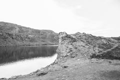 Lake in rock of montains black and white Royalty Free Stock Photography