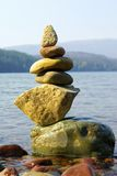 Lake Rocks D. Close-up view of beautiful rock cairn on shore of lake Stock Images