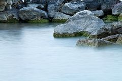 The lake rocks. Photo of rocks in the water Royalty Free Stock Images
