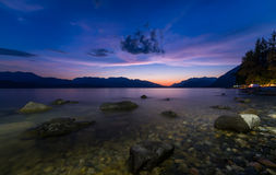 Lake With Rocks and Purple Sky Stock Photography