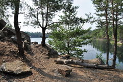 Lake with rocky shores. Landscape, lake with rocky shores, forest Royalty Free Stock Photos
