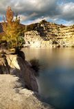 Lake in rocky valley. Scenic view of picturesque lake in rock, mountainous valley Royalty Free Stock Photo
