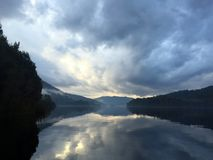 Lake Rosebery, Tasmania. Clouds and reflection in Tasmania Stock Images