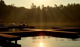 Sun rise at the Muskoka. Lake Rosseau is located in Ontario, Canada, about 200 km 120 mi north of Toronto. The lake is surrounded by many cottages, some dating Stock Photos
