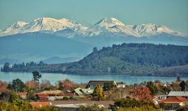 Lake Rotorua Switzerland.Cityscape New Zealand. Lake Rotorua Switzerland.Cityscape New Zealand in bright spring Stock Photos