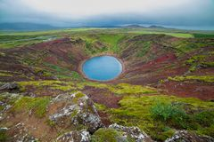 Lake in round volcano crater Stock Photo