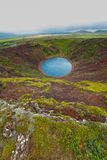 Lake in round volcano crater Stock Photos