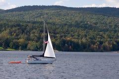 Lake Sailing. Sailboat Cruising on a Lake stock images