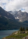 Lake Saint Mary, Glacier National Park. Photo of Lake Saint Mary and a sharp peak at Glacier National Park in Montana stock photo