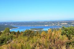 Lake of Sainte-Croix with Costebelle island. Verdon Gorge. South of France. stock photography