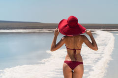 The lake with salt water. Baskunchak . Beautiful woman sunbathin stock photography