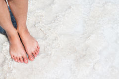 The lake with salt water. Feet on the shore Stock Photography