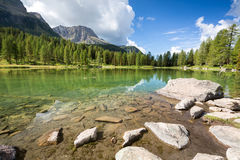 Lake San Pellegrino, Dolomites, Italy. Lake San Pellegrino during hot summer season, Dolomites, Italy Stock Photos