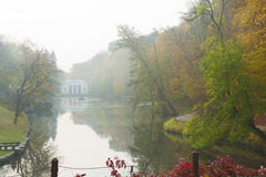 Lake scene in autumn park. In the morning Royalty Free Stock Photo