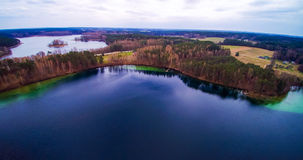 Lake scenery aerial Lithuania. Lake scenery aerial view. Forest and island visible from bird's view flight. Lithuania, Moletai region, lake Luokesai Stock Photos