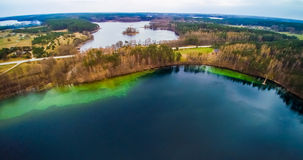 Lake scenery aerial Lithuania. Lake scenery aerial view. Forest and island visible from bird's view flight. Lithuania, Moletai region, lake Luokesai Royalty Free Stock Photography