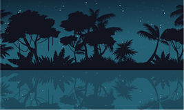 Lake scenery on jungle silhouette at night Royalty Free Stock Photography