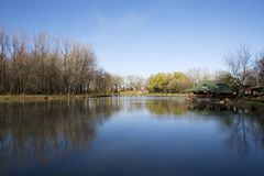 Lake scenic. With blue sky and calm water Royalty Free Stock Photo
