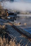 Lake schliersee gravel beach and boathouse in the morning sun Stock Photo