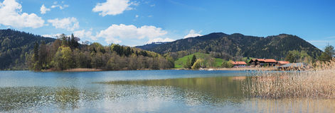 Lake schliersee with springlike hills and boathouses Royalty Free Stock Image