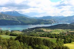 Lake Serre-Poncon valley between the Hautes-Alpes mountains, France royalty free stock photography