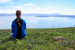 Lake Sevan is the largest body of water in Armenia and in the Caucasus region. Blue expanses of water, mountains, a meadow with fl royalty free stock images