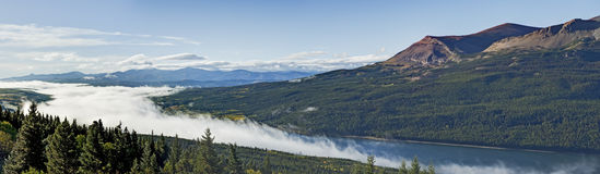 Lake Sherburne under Blanket of Clouds Stock Images