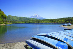 Mount Fuji and Lake Saiko. Lake Saiko with Mount Fuji in the background and blue dinghies in the foreground and on the right stock photography