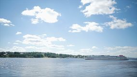 Lake from the shore against a blue sky stock footage