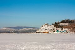 Lake shore in winter. Lake shore in a cold winter day Royalty Free Stock Photo