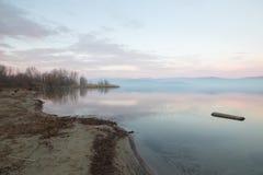 Lake shore at dusk Stock Images